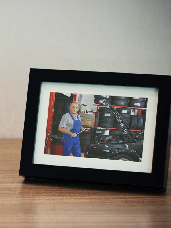 A picture of a mechanic in a desktop picture frame